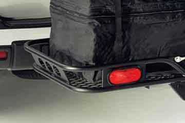 Black steel hitch cargo carrier with black baggage on white car