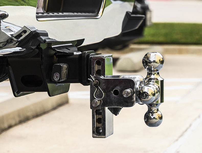 Tow hitch black and chrome on a white pick up truck